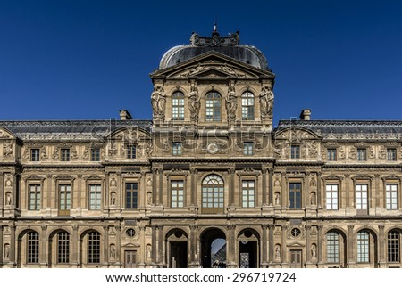 PARIS, FRANCE - APRIL 24, 2015: Architectural fragments of buildings in courtyard Cour Carree of Louvre Museum. Louvre Museum is one of the largest and most visited museums worldwide. - stock photo