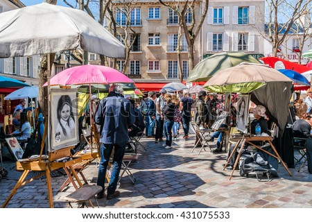 PARIS, FRANCE - APRIL 23, 2015: Artists easels and artwork set up in Place du Tertre in Montmartre. Montmartre attracted many famous modern artists including Picasso and Dali.