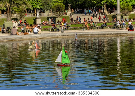 PARIS, FRANCE - APRIL 23, 2015: Children's ships in pond near Luxembourg Palace in Luxembourg Garden (Jardin du Luxembourg - second largest Public Park in Paris). Luxembourg palace hosts French Senate - stock photo