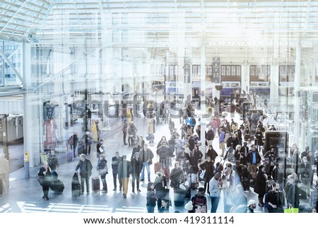 PARIS, FRANCE - APRIL 10 2016: Commuters in modern train station, people waiting in new terminal of Gare de Lyon - stock photo