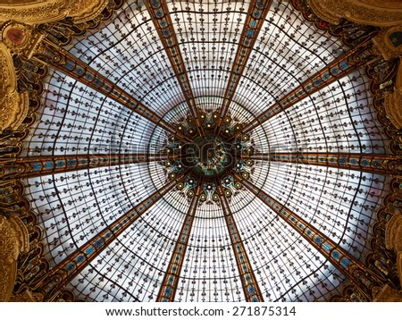PARIS, FRANCE - APRIL 7, 2015: Dome inside Lafayette shopping center. The Galeries Lafayette has been selling luxury goods since 1895.  - stock photo