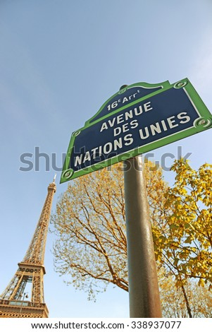 Paris, France - April 14, 2015: Eiffel Tower with street sign in foreground