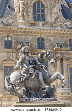 PARIS, FRANCE -  APRIL 25,2013: Equestrian statue of king Louis XIV in the courtyard of the Louvre museum. Made by Gian Lorenzo Bernini. - stock photo