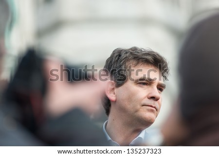 PARIS, FRANCE - APRIL 6: French Minister for Industrial Renewal Arnaud Montebourg supports made in France and talks to the employees of the company Blanc de Vosges at Montmartre. Paris, April 6, 2013