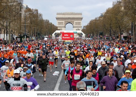 PARIS, FRANCE - APRIL 6: Group of runners start on Champs Elysees  the Paris Marathon, April 6, 2008 in Paris, France