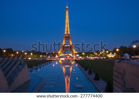 PARIS, FRANCE - April 23, 2015 :Illumination of the Eiffel tower at night.The Eiffel Tower is an iron lattice tower located on the Champ de Mars in Paris, France. - stock photo