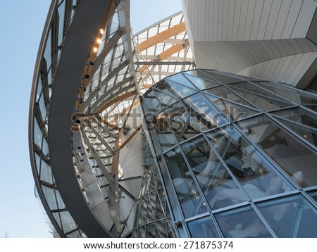 PARIS, FRANCE - APRIL 7, 2015: Louis Vuitton Foundation building. Made of 3,584 laminated glass panels, it was designed by the architect Frank Gehry and opened to the public in 2014. - stock photo