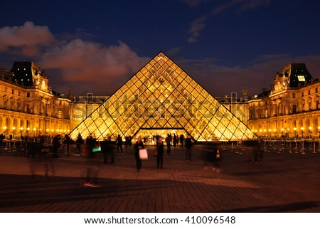 PARIS, FRANCE - APRIL 8, 2016: Louvre Pyramid at Louvre Museum at night is one of famous museum and  the most visited museum in the world