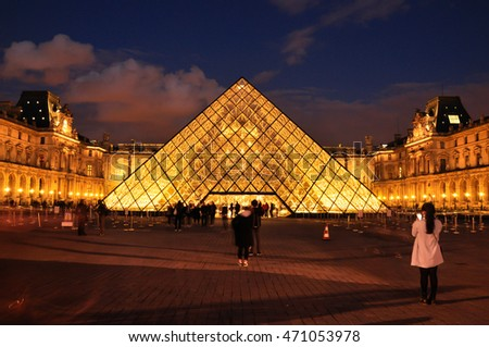 PARIS, FRANCE - APRIL 8, 2016: Louvre Pyramid at Louvre Museum is one of famous museum and  the most visited museum in the world
