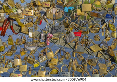 PARIS, FRANCE - APRIL 11, 2012: Love padlocks fixed at balustrade of Pont des Arts (Arts Bridge) in Paris; France. - stock photo