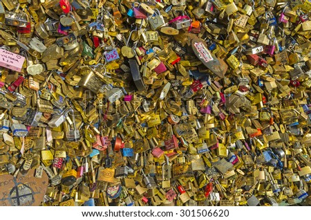 PARIS, FRANCE - APRIL 9, 2014: Love padlocks fixed at balustrade of Pont des Arts (Arts Bridge) in Paris; France.
