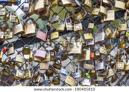 PARIS, FRANCE -  APRIL 26:Love padlocks on Pont des Arts bridge on april 26, 2013 in Paris.16000 lockers of loving couples are on that bridge, also known as Passarelle des Arts.