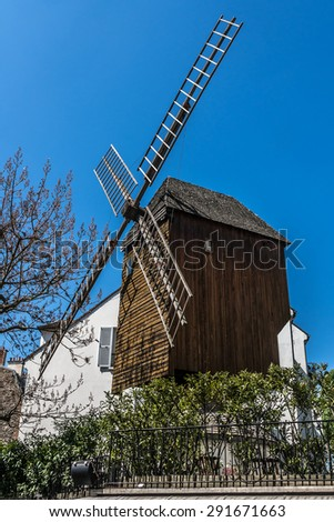 PARIS, FRANCE - APRIL 23, 2015: Moulin de la Galette (or Moulin Blute-Fin, 1622) - oldest windmill of Montmartre. In mill, there is still a working mechanism. Now it houses guinguette and restaurant.