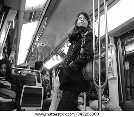 PARIS, FRANCE - APRIL 6, 2015: People in train of Line 1 in Parisian Metro. The Paris Metropolitan is serving over 1.5 billion passengers per year. - stock photo