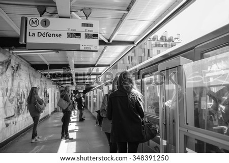 PARIS, FRANCE - APRIL 6, 2015: People waiting to the train at Bastille station of Line 1 in Parisian Metro. The Paris Metropolitan is serving over 1.5 billion passengers per year. - stock photo