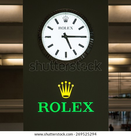 PARIS, FRANCE - APRIL 5, 2015: Rolex watch signboard inside Charles de Gaulle airport. Rolex was founded in 1909. It produces about 2,000 luxury watches daily. - stock photo