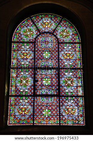 PARIS, FRANCE - APRIL 20, 2013: Stained glass window decorated with flowers in Church of St Eustace. Saint-Eustache was built in 1532-1632 and considered a masterpiece of late Gothic architecture.