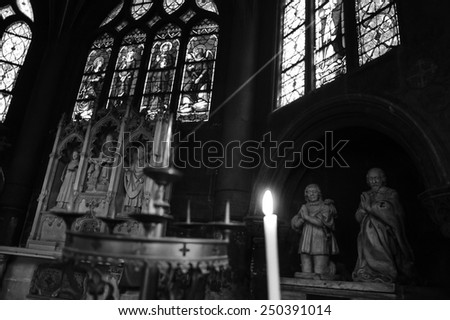 PARIS, FRANCE - APRIL 21, 2013: Sunbeam passing through stained-glass window illuminates interior of St Eustace church. Saint-Eustache, masterpiece of late Gothic architecture, was built in 1532-1632. - stock photo