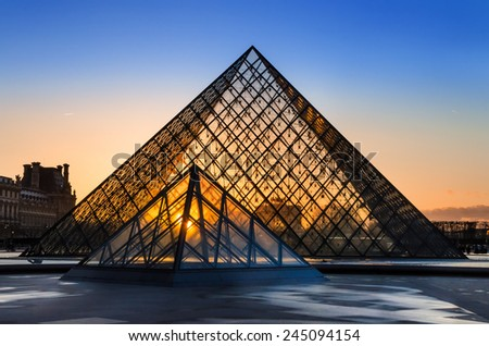 PARIS, FRANCE - APRIL 12: The Louvre and pyramid during  sunset on april 12, 2013 in Paris, France. - stock photo