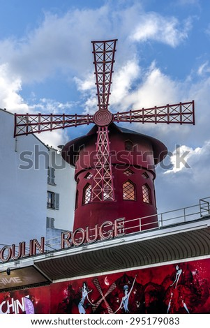 PARIS, FRANCE - APRIL 25, 2015: The Moulin Rouge. Moulin Rouge is a famous cabaret built in 1889, locating in Paris red-light district of Pigalle on Boulevard de Clichy.