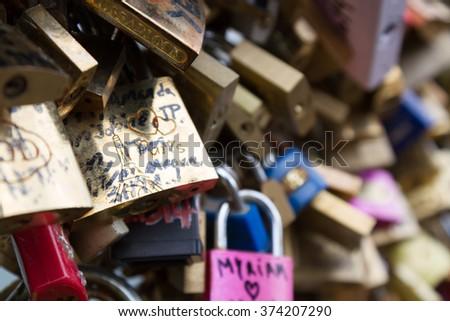 Paris, France-April 06, 2014. Thousands of padlocks known as love locks adorn the Pont des Arts bridge that spans the Seine River in Paris, France - stock photo
