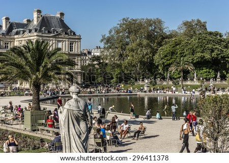 PARIS, FRANCE - APRIL 23: Tourists and Parisians relaxing in Luxembourg Garden (Jardin du Luxembourg). Jardin du Luxembourg - second largest Public Park in Paris. Park is garden of French Senate.
