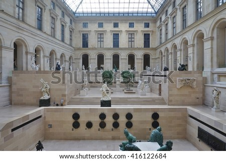 PARIS, FRANCE -11 APRIL 2016- Under the Pyramide du Louvre, a glass pyramid designed by architect I. M. Pei in the Cour Napoleon main courtyard in the Louvre Museum in Paris. - stock photo