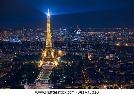 PARIS, FRANCE - AUGUST 29 2015: beautiful night scene of illuminated Eiffel Tower and panoramic aerial view of Paris, France