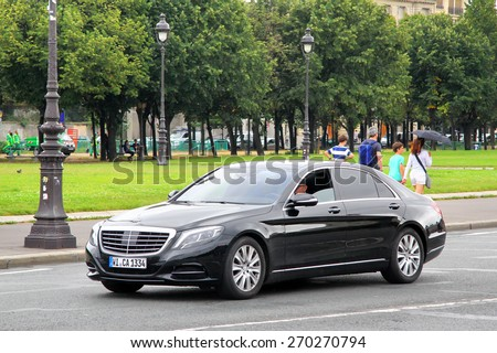 PARIS, FRANCE - AUGUST 8, 2014: Black luxury car Mercedes-Benz W222 S-class at the city street. - stock photo