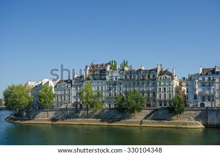 PARIS, FRANCE - AUGUST 22, 2015: Ile St-Louis in the heart of the city has some of  the most expensive real estate in the city with historic homes overlooking the Seine. - stock photo