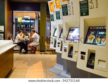PARIS, FRANCE - AUGUST 10, 2015: McDonald's restaurant interior. McDonald's is the world's largest chain of hamburger fast food restaurants, founded in the United States. - stock photo