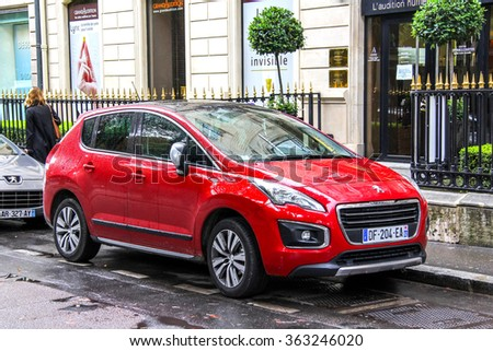 PARIS, FRANCE - AUGUST 8, 2014: Motor car Peugeot 3008 in the city street. - stock photo