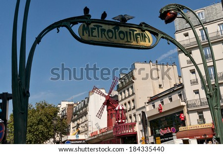PARIS, FRANCE - AUGUST 30: Moulin Rouge on August 30, 2013 in Paris. Famous cabaret was opened in 1889.