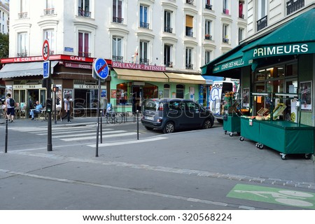 PARIS, FRANCE - AUGUST 10, 2015: Paris streets. Paris, aka City of Love, is a popular travel destination and a major city in Europe - stock photo