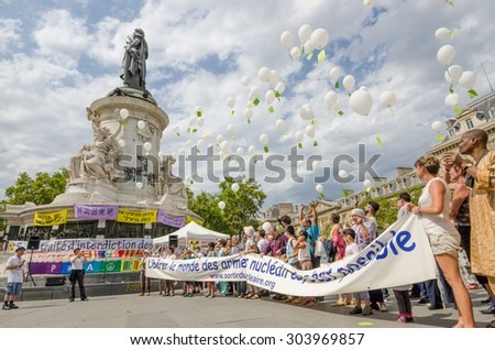 PARIS, FRANCE   AUGUST 7, 2015: People are demonstrating for the end of nuclear war at the Place de la Republique on the 70th anniversary of the bombing of Hiroshima and Nagasaki in Japan.