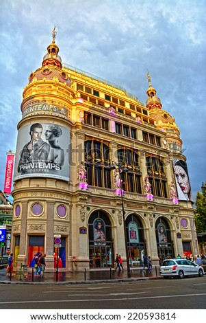 PARIS, FRANCE  - AUGUST 22: Printemps - largest beauty Department Store in world with 45000 square meters of shopping on August 22, 2014 in Paris. Printemps facade registered as Historic Monument. - stock photo