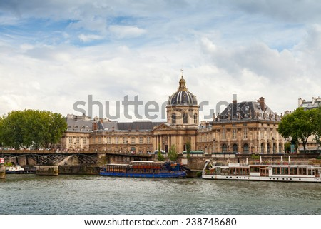 Paris, France - August 07, 2014: Seine river coast with Facade of Institute de France in Paris. Architect Louis Le Vau, was made between 1662 and 1688 - stock photo