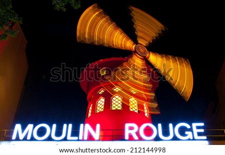 PARIS, FRANCE - AUGUST 4TH 2014: The famous Moulin Rouge in Paris on the 4th August 2014. - stock photo