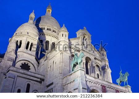PARIS, FRANCE - AUGUST 4TH 2014: The magnificent Basilique du Sacre Coeur de Monmartre at dusk in Paris on 4th August 2014. - stock photo