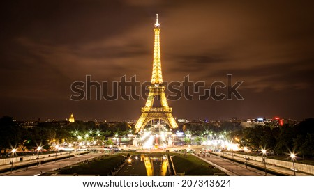 PARIS, FRANCE - AUGUST 23, 2012: The Eiffel Tower Tourist Attraction in Paris at night. - stock photo