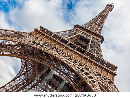 PARIS, FRANCE - AUGUST 22, 2012: The Eiffel Tower Tourist Attraction in Paris, view from below - stock photo