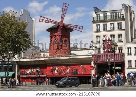 Paris, France - August 17: The Moulin Rouge theatre in Paris, France on August 17, 2014. The Moulin Rouge is a famous cabaret built in 1889, located in the Paris red-light district of Pigalle. - stock photo