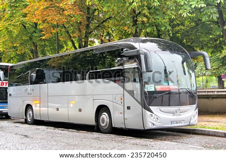 PARIS, FRANCE - AUGUST 8, 2014: Touristic coach Irisbus Magelys Pro at the city street. - stock photo