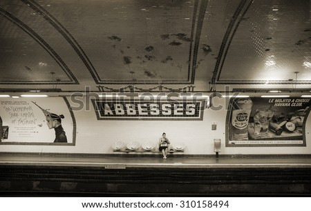 PARIS, FRANCE - AUGUST 10: Typical parisian metro station, 'Abbesses' in Montmartre - old famous historical artistic area on August 10, 2015 in Paris, France.