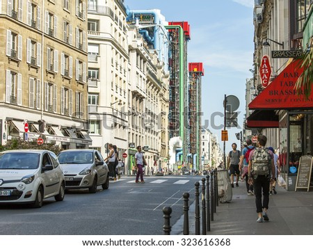 PARIS, FRANCE, AUGUST 28, 2015. Urban view. Typical Parisian street in the bright sunny day.