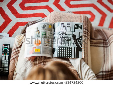 PARIS  FRANCE   AUGUST 24  2014  View from above of woman reading IKEA. Ikea Catalogue Stock Images  Royalty Free Images   Vectors