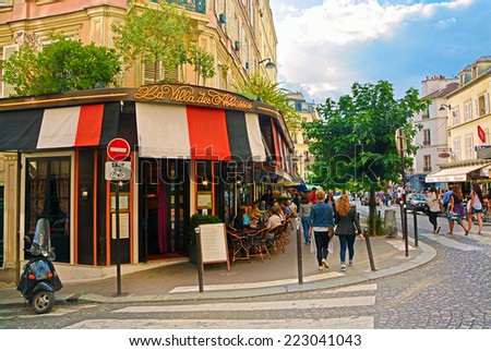 PARIS, France -August 16, 2014: View of typical paris cafe in the artists' quarter of Montmartre