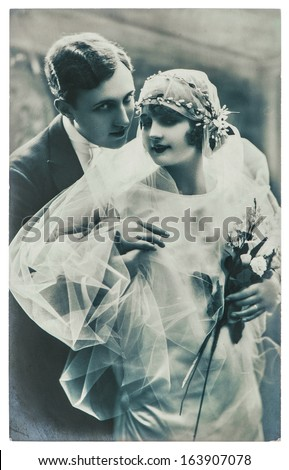 PARIS, FRANCE - CIRCA 1920: antique wedding photo. portrait of just married couple. bride and groom wearing vintage clothing. nostalgic picture, circa 1920 in Paris, France - stock photo