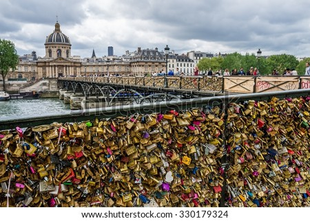 Paris, France - Circa April 2015 - People on the Pont des arts - stock photo