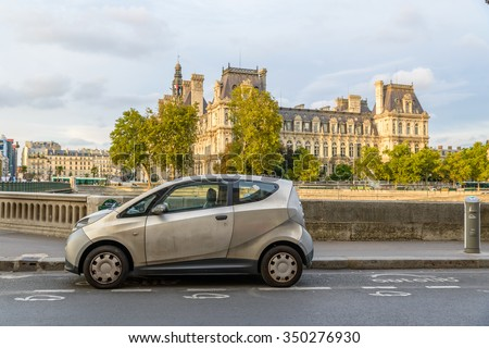 PARIS, FRANCE - CIRCA AUGUST 2015: An Autolib' is parked at an Autolib' station and charging point. Autolib' is an electric car sharing service. - stock photo